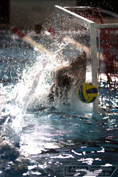 Australian goalie Alicia McCormack faces a wall of water as she prevents a goal from Canada during the women's heats on day 4.