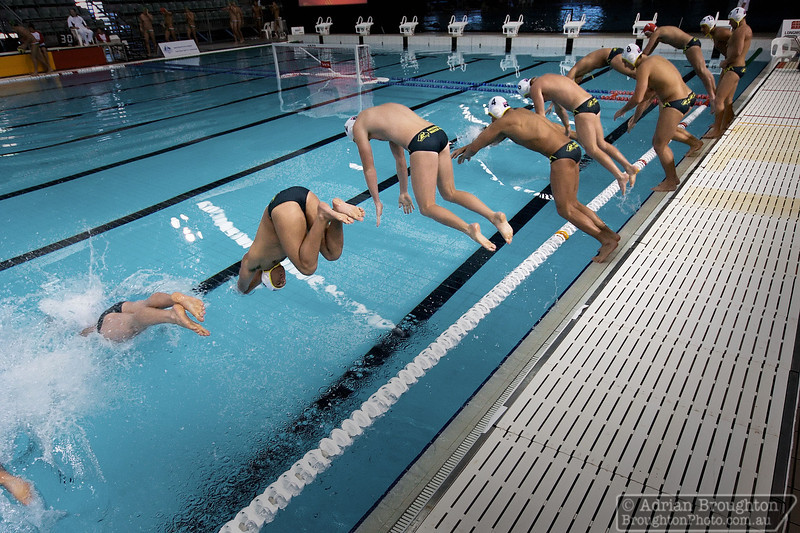 The Australian men's team enter the pool at the start of their Semi-final game against South Africa on day 7.