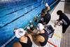 The New Zealand women's team listen to coach Peter Szilagyi during a time-out in the heat against Australia on day 5.