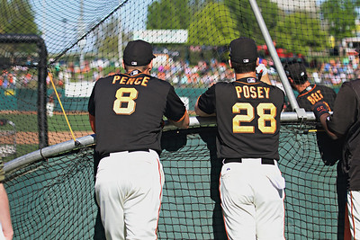 Hunter Pence and Buster Posey watch batting practice at Raley Field