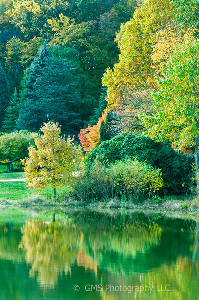Reflection of fall colors in lake at Holmdel Park, Holmdel, New Jersey