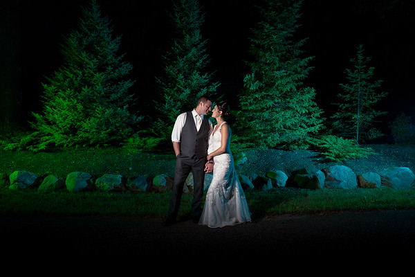 A moment between Corey & Brie as they slip away from their Chippewa Retreat Wedding by Northwoods wedding photographer Fornear Photo