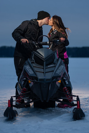 Three Lakes Snowmobile Engagement Photos