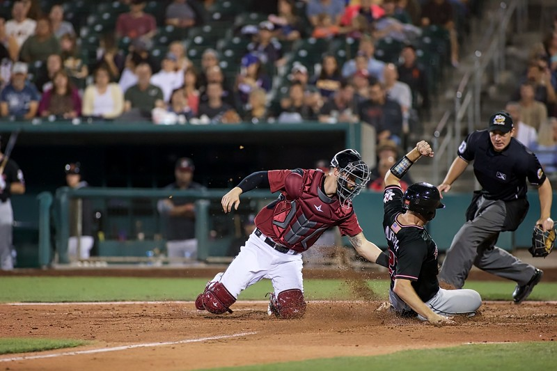 River Cats catcher Trevor Brown tags out Albuquerque's Garrett Hampson on Aug. 30, 2018