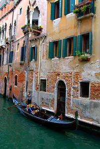 Gondolier with Tourists, Venice, Italy