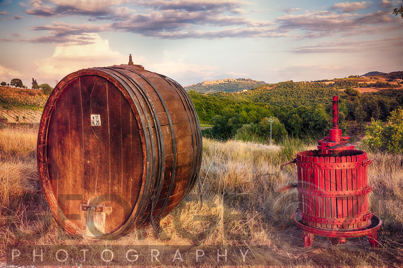 Wine Barrel and Grape Press Along a Country Road, Tuscany, Italy