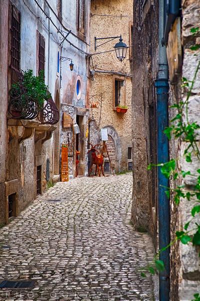 Narrow Cobblestone Street in a Medieval Town With a Cheese Shop, Sermoneta, Latina, Italy