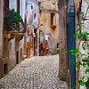 Narrow Cobblestone Street in a Medieval Town With a Cheese Shop, Sermoneta, Latina, Italy