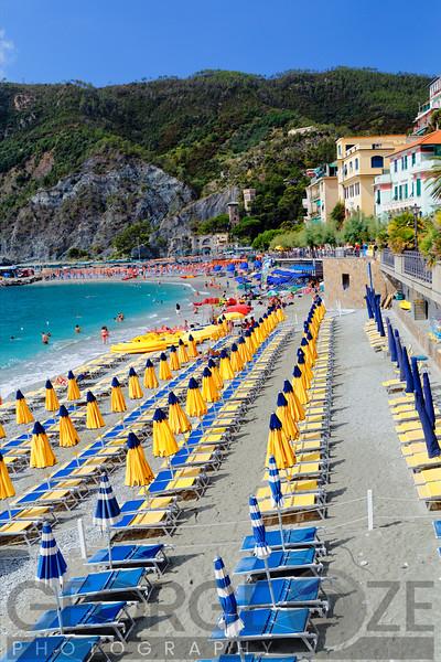 Row of Lounge Chairs and Umbrellas on a Beach, Monterosso Al Mare, Cinque Terre, Liguria, Italy