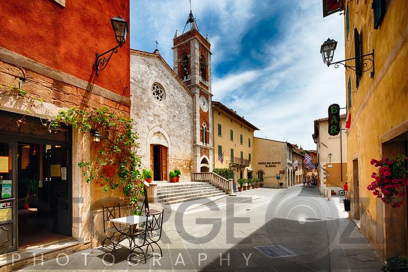 Street with a Catholic Church, San Quirico, Tuscany, Italy