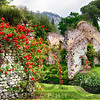 Garden with Historic Ruins and Blooming Flowers, Latina, Italy