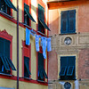 Close Up View of a House Facade with Shuttered Windows and Clothes Drying, Portofino, Liguria, Italy