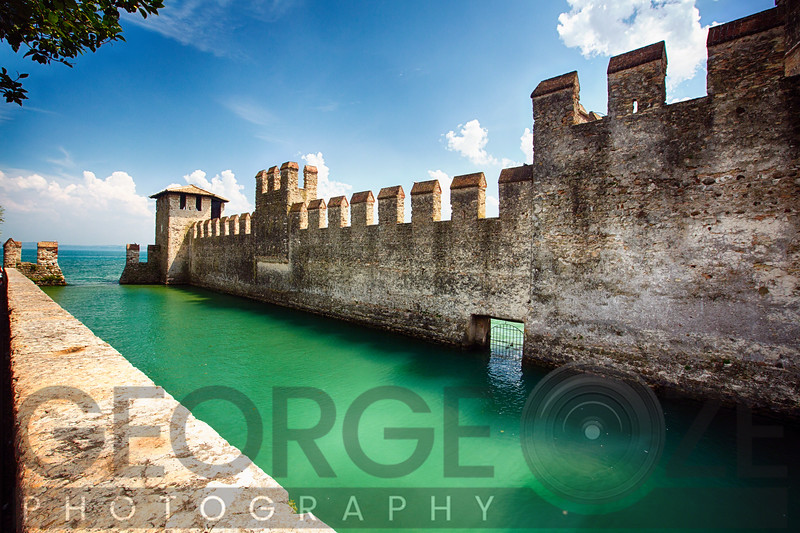 Low Angle View of a Castle in the Lake, Scaliger Castle, Sirmione, Lake Garda, Lombardy, Italy