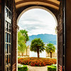 Scenic View of a Mediterranean Garden Through a Villa Door, Malcesine, Lake Garda, Italy