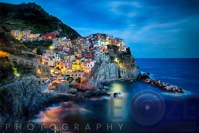 Cliffside Town at Night, Manarola, Liguria, Italy.