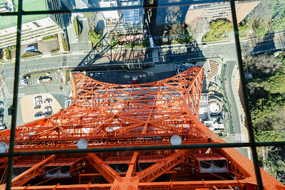 View through glass floor to base of Tokyo Tower.