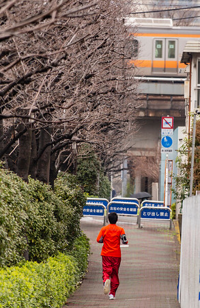 Jogger and train; Kandagawa River, Okubo.