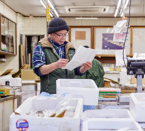 Fish Market Manager, checks orders. Shinjuku