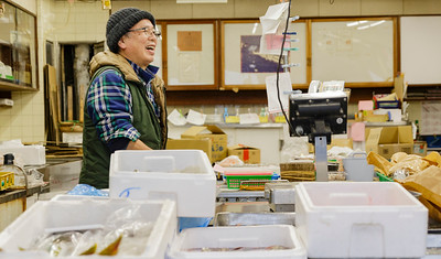 Fish Market Operator smiles and laughs, welcoming us to photograph.  Shinjuku