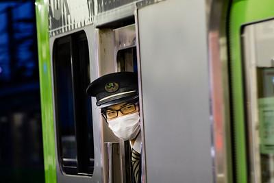 Train Conductor; Shin-Okubo station.
