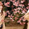 Friends photograph each other at Shinjuku Gyoen National Garden