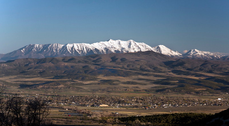 Mount Nebo (11,877 ft) and Northern Peak (11,928 ft) as seen from the hills east of Mount Pleasant. Mount Nebo is the southernmost and highest mountain in the Wasatch Range of Utah in the United States. April 21, 2012.