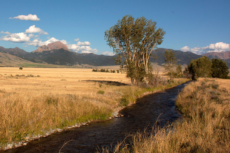 The Helmet (on the left) in the Madison Range plus irrigation canal. Aug 3, 2012