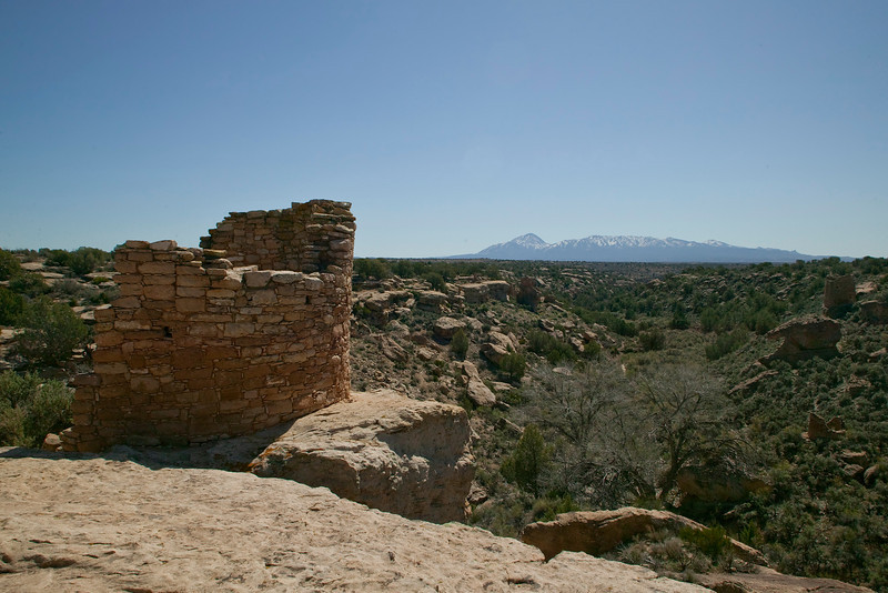 Sleeping Ute Mountain from Hovenweep National Monument. Ruins (Utah) in foreground are over 700 years old. The Sleeping Ute looks like an Indian (or a person) lying down with arms folded. (Really it does.) April 2010.