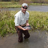 Hatcheries employee with Arctic Grayling in Red Rock Creek, Montana. May 16, 2012.