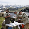 Fisheries biologists confer on the processing of an Arctic Grayling along Red Rock Creek in Montana. May 16, 2012