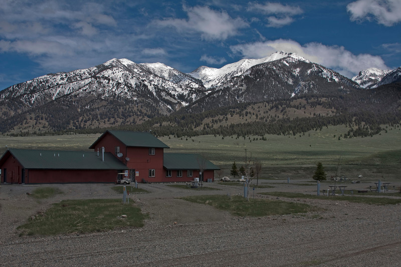View of RV spaces and Clubhouse/office of Driftwaters Resort in Cameron, MT, next to the Madison River.