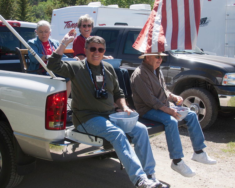Steve Rector, Bob and Ida Shook, with Patty Bullock in the parade's lead truck at RedRock RV Parks annual Fourth of July parade and festival. July 2, 2011.