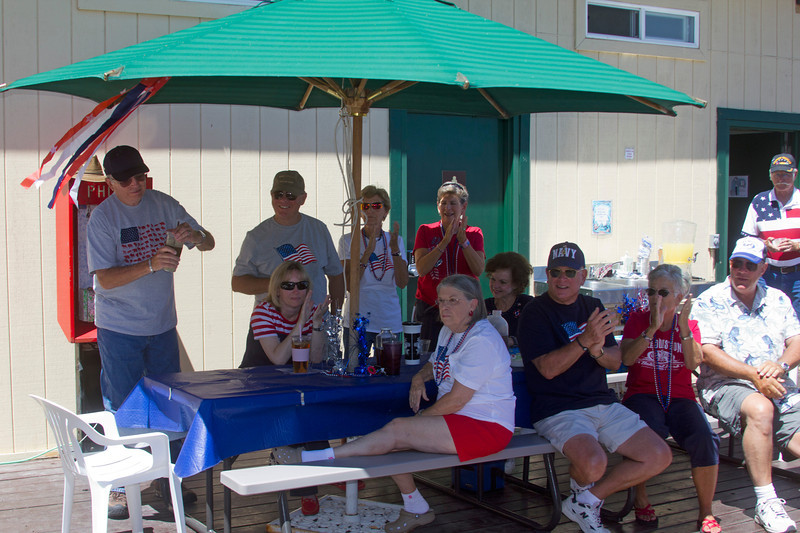 Fourth of July potluck at RedRock RV Park. July 2, 2012.<br /> From left, Steve, Karen, Larry, Mary, Jackie, Sharon, then in front, Patty, Larry, Bridgette, and Frank.  (Dan Walker in back).