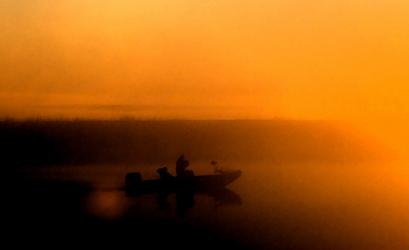 Abstract of fisherman on Molenumne River near Isleton, Ca at Sunrise. Nov 28, 2010.