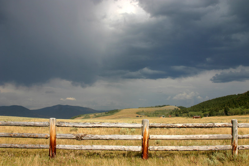 Ranch Fence and storm over Yellowstone Plateau. From Henry's Lake South Access Road, Island Park, Idaho, Summer 2006