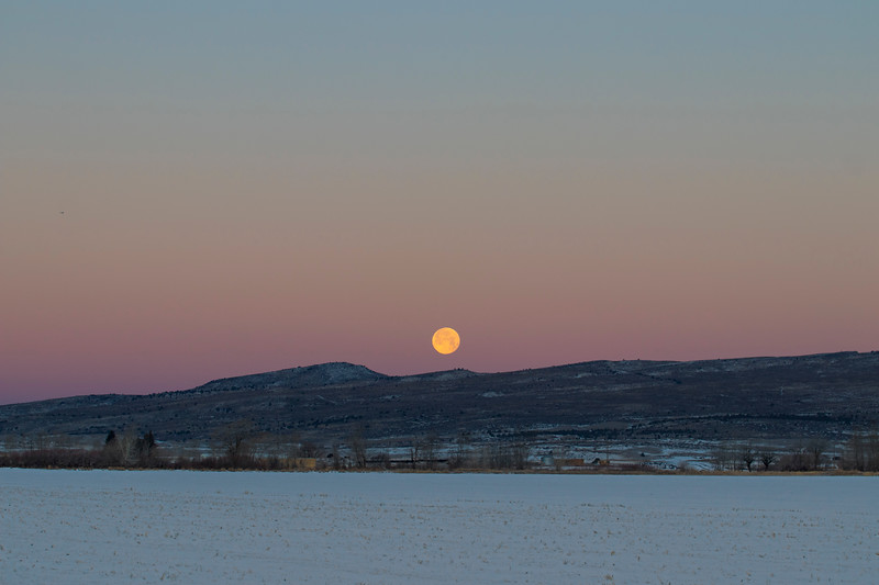 Super Moon over Saint Anthony Sand Dunes and snow field