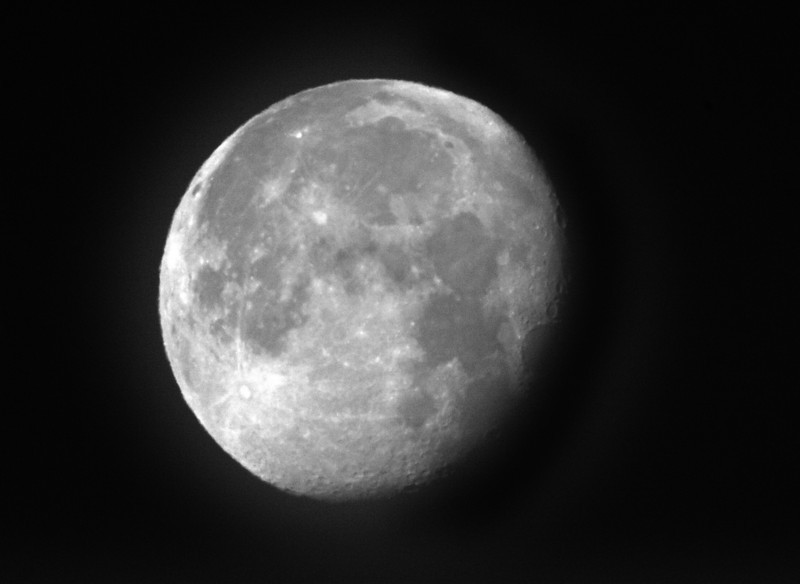 Moon during the bright morning hours, processed to grayscale and darkened for contrast. The focus is not as good as taking the photo during the night. Presumably the light scattering causes this lack of good focus? Jan 13, 2009 from Silent Valley Club, near Banning, CA.  Equivalent of 1600mm lens.