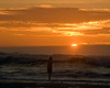 Girl playing in surf during sunset at Lincoln City, Oregon on Nov 2, 2009