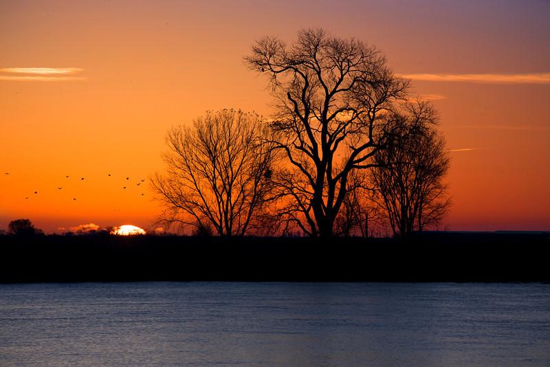 Sunrise along the  lower Mokelumne River at Sunrise in the Sacramento River Delta region, near Isleton, CA. Dec 2012