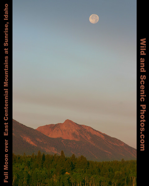 Full moon setting over the East Centennial mountains in Idaho with the smoke from a large fire 200 miles away layered in the sky. August 2007