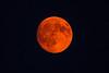 Full Moon rising through thick smoke