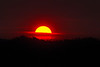 Sun rising over the yellowstone plateau on a smokey morning on August 17, 2013 near Island Park, Idaho.