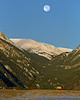Moon setting over Rocky Mountain National Park and Elk. This photo was taken in the mid-90's and digitized using PhotoCD technology.