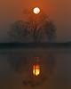 Sun reflected in the lower Mokelumne River in the Sacramento River Delta. Dec 11, 2012.