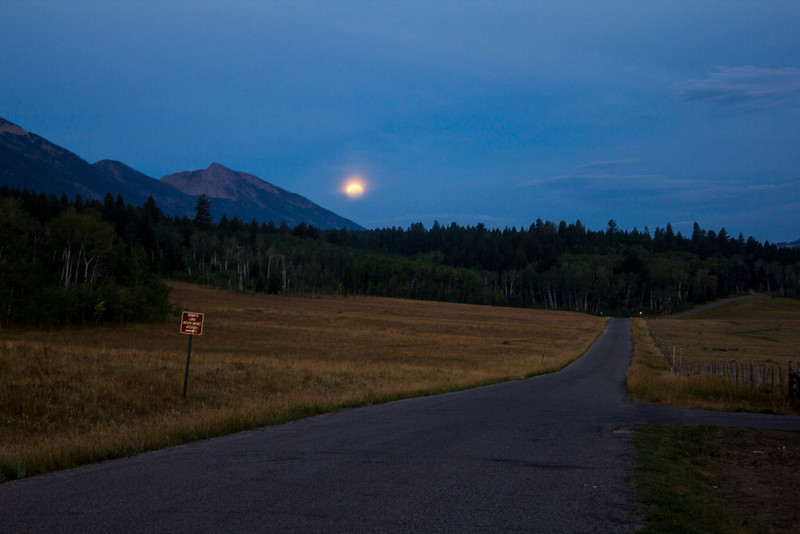 Blue moon setting over Mt. Nemesis on Aug 31 2012 morning. Idaho.  Red Rock Road.