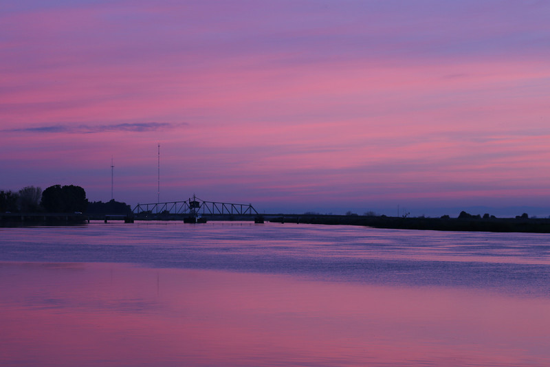 Beautiful purple hues surround the bridge over the lower Molekumne River bridge near Isleton, CA in the Sacramento Delta on December 9, 2012 right before sunrise.