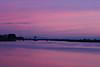 Beautiful purple hues surround the bridge over the lower Molekumne River bridge near Isleton, CA in the Sacramento Delta on December 9, 2012 right before sunrise.