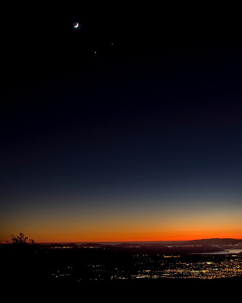 Dec 1, 2008 this close encounter between the moon, venus (bottom), and Jupiter occurred. This is a view from the San Jacinto Mountains in Southern California, overlooking the town of Hemet, CA. Unfortunately, getting everything in correct exposure was impossible, so what you see is what you get! Click on the image for a larger view.