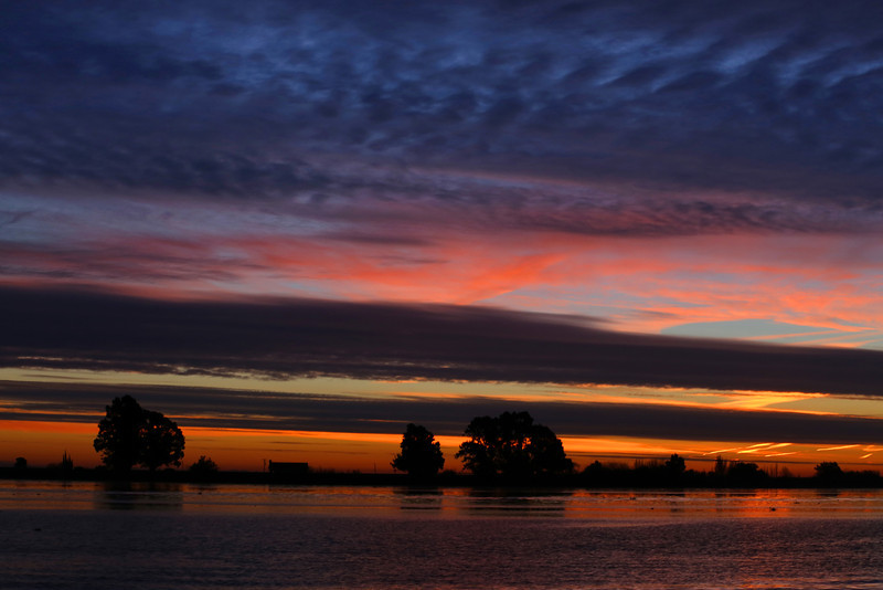 Beautiful layered sky and the Sacramento River at sunrise, Dec 14, 2012.