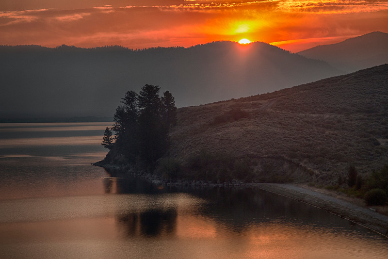 Henry's Lake Sunrise with Yellowstone Fires